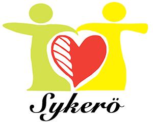 Sykerö-kerhon tunnus, joka koostuu kahdesta hahmosta, joiden keskellä on sydän sekä tekstistä Sykerö.